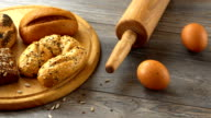 Fresh homemade pastry, eggs, and flour on a rustic wooden table. Natural and healthy eating video