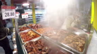 Fresh hot cooked meat for sale at Chinese supermarket. video