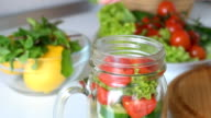 Fresh mixed vegetables salad in glass jar. Concept of cooking. video