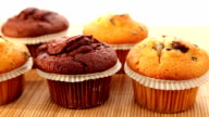 Fresh muffins with chocolate - dolly shot video