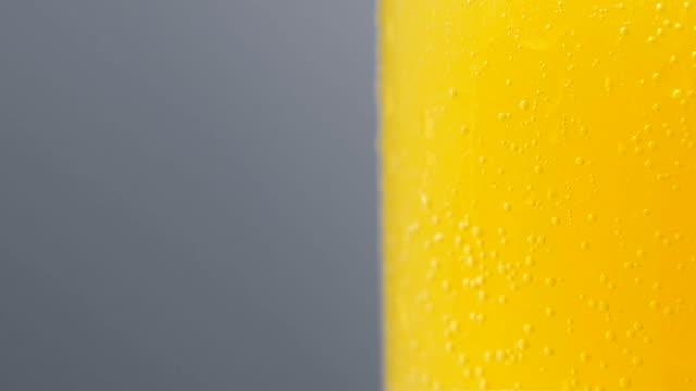 Fresh orange fruit in a glass of soda water video