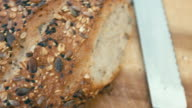 fresh organic bread baked with healthy nuts and sesame seeds video