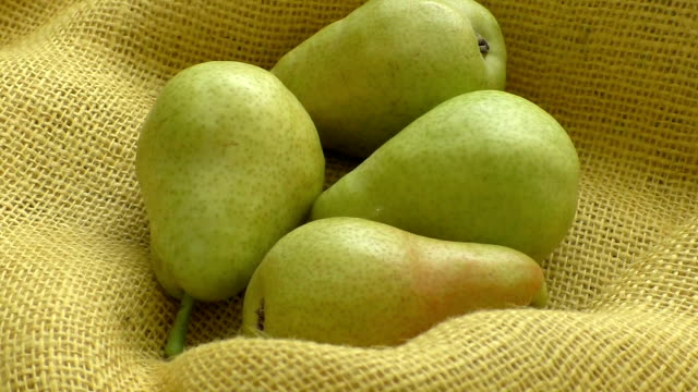 Fresh organic pears on yellow sacking. Pear autumn harvest. Juicy flavorful pears of rustic background. video