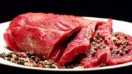 Fresh raw beef meat with peppercorns ready to grill, rotating video