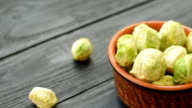 Fresh raw organic green brussel sprouts in a ceramic video