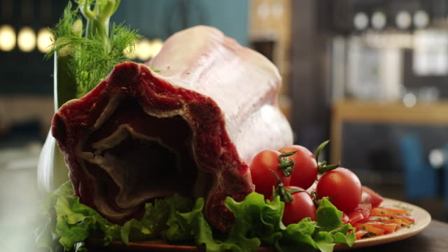 Fresh raw pork ribs on plate with ingredients beside video