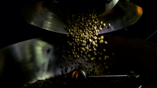 Fresh Roasted Coffee Beans Spilling from Roaster video