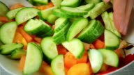 Fresh salad of tomato and green cucumber video
