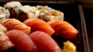 Fresh salmon and tuna sushi video