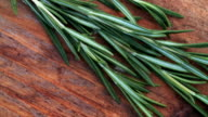 Fresh sprig of rosemary on a vintage wooden surface video