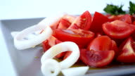 Fresh tomatoes salad with olive oil dressing, dolly shot video