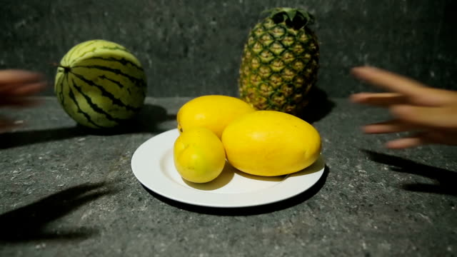 fresh tropical fruits on plate video