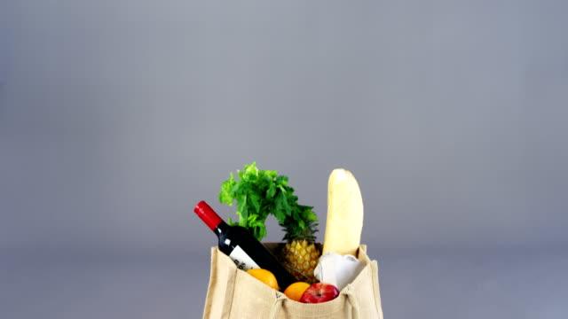 Fresh vegetables, fruit, bottle in shopping bag video