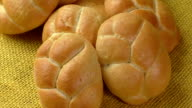 Fresh wheat buns on the sacking background video