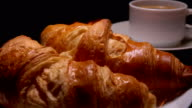 Freshly baked croissants with coffee for breakfast video