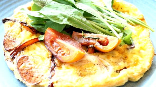 Fried eggs omelette in white plate video