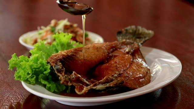 Fried fish topped with a tasty sauce. video