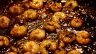 Fried king prawns in iron pan video