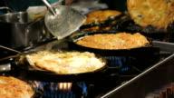 Fried mussel pancakes in hot plate, Thai food video
