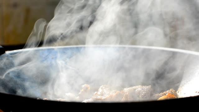 fried pork in a pan video