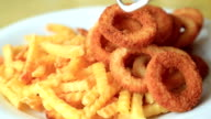 Fried potatoes and onion rings video