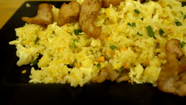 Fried rice pork and vegetable in motion. video