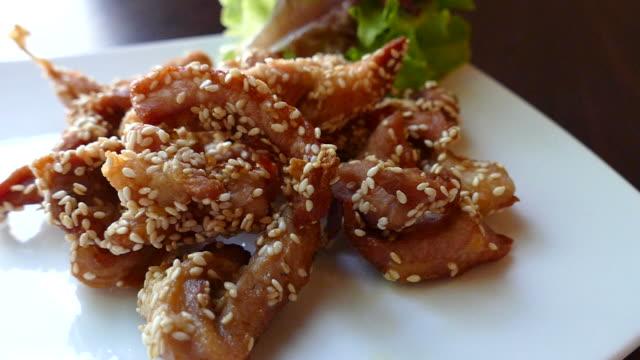 Fried sliced pork with white sesame video