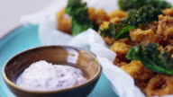 Fried squid with kale and sumac mayo, extreme close up, pan video