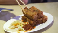 Fried turnip cake with chili sauce and vegetable video