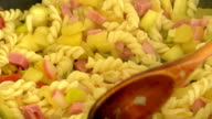 Fried vegetables,pasta,egg in a pan close-up video