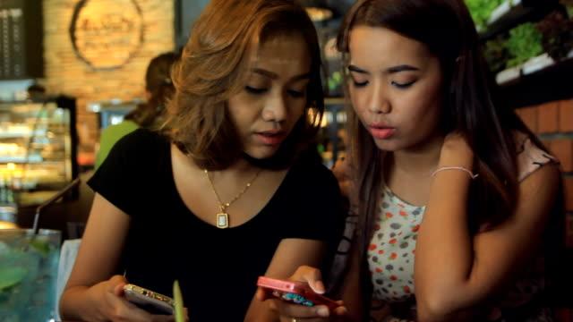 Friend looking at Digital Tablet in Coffee Shop video