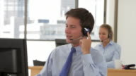 Friendly Service Agent Talking To Customer In Call Centre video