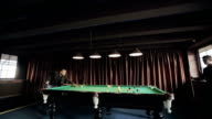 Friends are playing pool billiards. Time lapse video