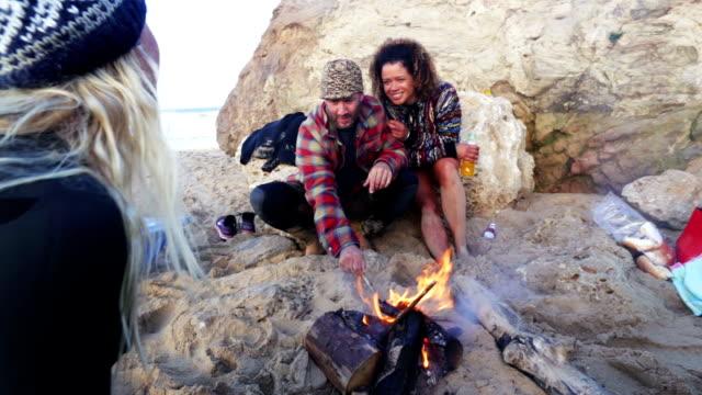 Friends Around a Beach Camp Fire video