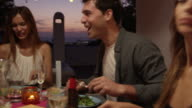 Friends at a dinner party on a roof terrace, close up, Ibiza, shot on R3D video