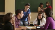 Friends at school, group of college students talking in class video