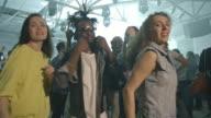 Friends blowing up dance floor at concert video