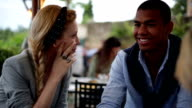 Friends chattering at italian restaurant video HD video