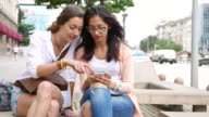 Friends chitchatting and browsing video