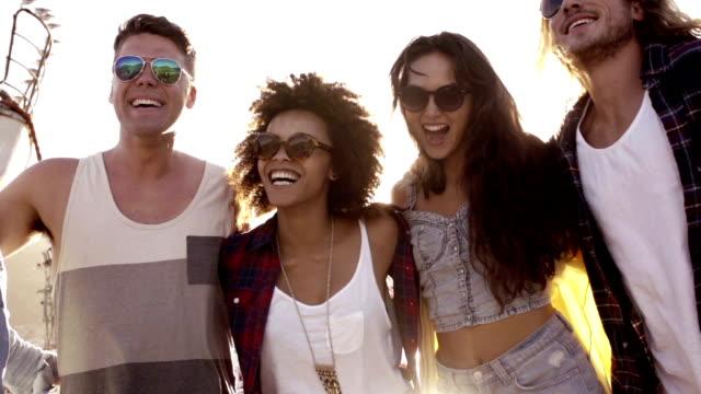 Friends dancing in the harbor video