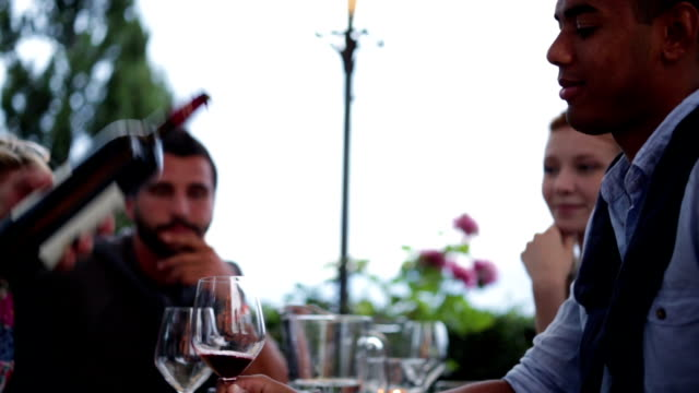 Friends drink wine at italian restaurant video HD video