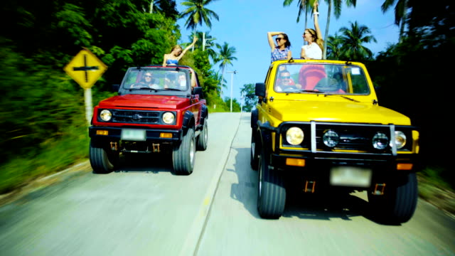 Friends driving 4x4 cars down the road video