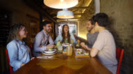 Friends eating together at a restaurant video