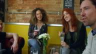 Friends Enjoying Drink In Bar Sitting On Sofa Shot On R3D video