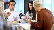 Friends Enjoying Meal At Restaurant video