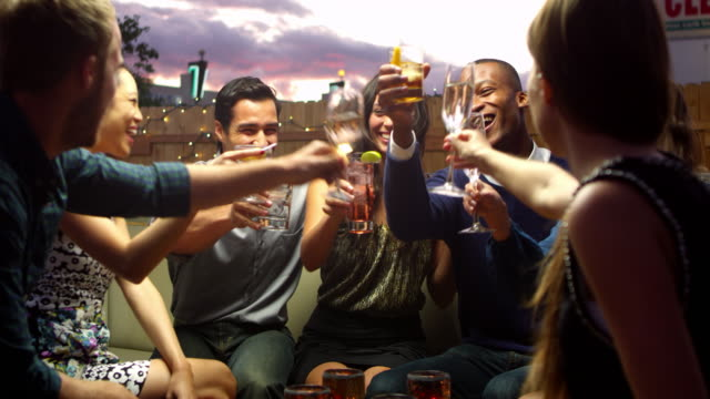Friends Enjoying Night Out At Rooftop Bar Shot On R3D video