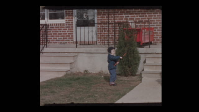 Friends gather around Little boy with toy riffle video