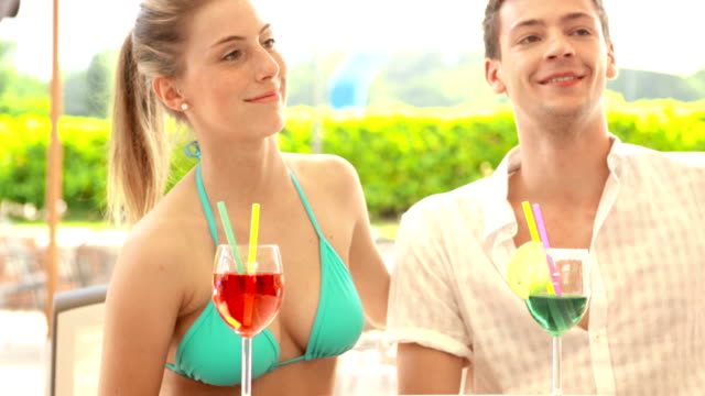 Friends has fun with cocktails in the pool video