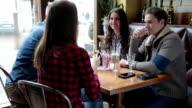Friends having coffee in cafe video