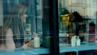 Friends having coffee together in cafe video